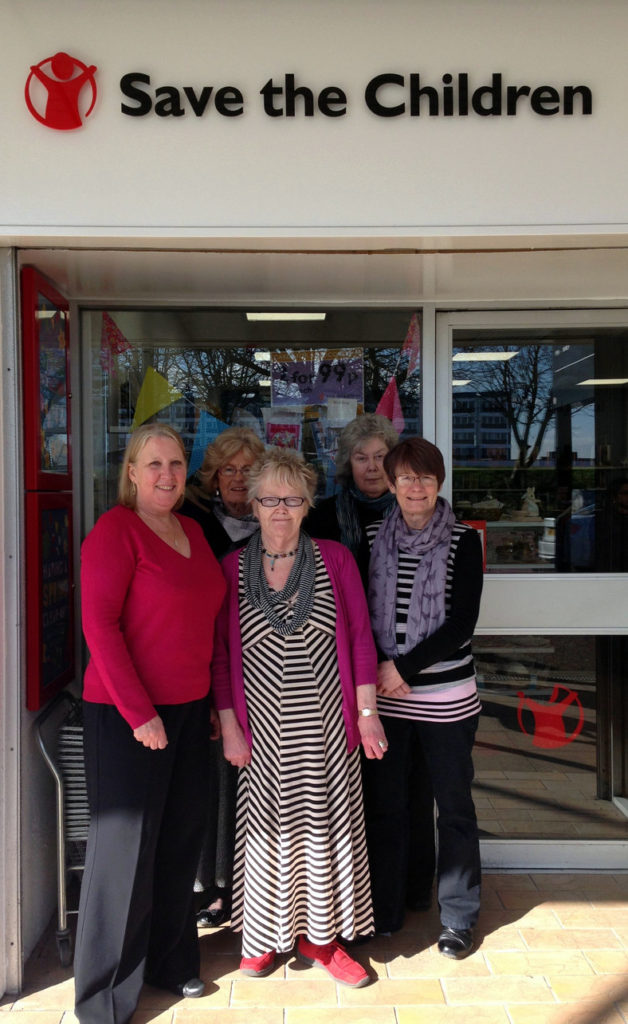 Frances pictured with several other volunteers from the highly successful Preston Shop .